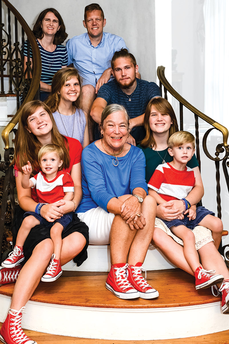 Peggy McDonald, center, surrounded by members of the Force family; left from top to bottom: Melody, Rachel, Lydia holding Joshua; right, from top to bottom: Raymond, Mark, Mary holding Caleb