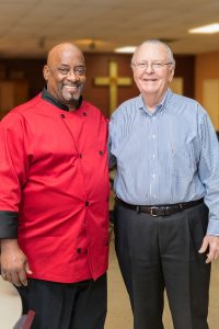 Former City Rescue Mission client Ronn Scott stands with his mentor, Bud Toole
