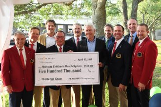 Members of THE PLAYERS Championship stepped up their own game when they presented a check to Nemours Children's Specialty Care for $150,000 more than the charity arm of the prestigious golf tournament enterprise had pledged as a matching grant. Red Coat and Blue Coat members made the exciting announcement April 26 with a $500,000 check for Nemours new capital campaign.