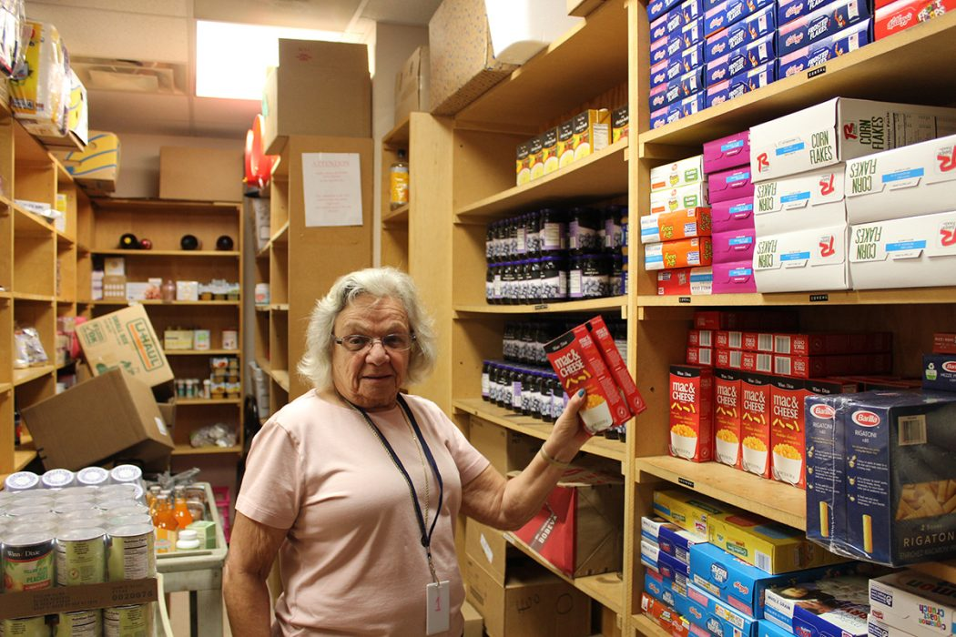 Volunteer Elaine Furman stocks the shelves in the Max Block Food Pantry at Jewish Family & Community Services.