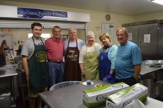 Volunteers Michael Olson, Pat Morrissey, Bill Kornmayer, Rita Kornmayer, Karen Fregeau, and Gary Gregeau from Our Lady Star of the Sea Catholic Church make a hot lunch for the folks at Mission House once a month.