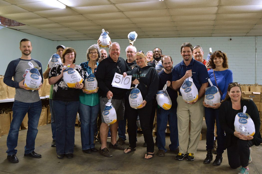 A group of Salvation Army volunteers led by Miracle-on-the-Hudson plane crash survivor Casey Jones, center, distributes turkeys at Thanksgiving time. In 2016, Jones collected 510 turkeys.
