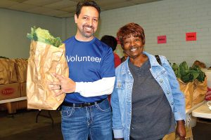 The Salvation Army depends on volunteers to help sort, pack, and distribute food.
