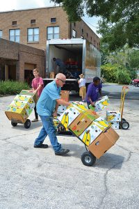 Volunteers from Trinity Lutheran Church Food Pantry Ministry unload supplies from a Feeding Northeast Florida truck.