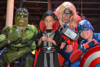 How many Avengers does it take to have a blast a Halloween Doors and More? As many as you can find – Hulk, Thor and Captain America took a little time from world-saving to come to the event. (Photo credit: David Luck, Community Hospice & Palliative Care)