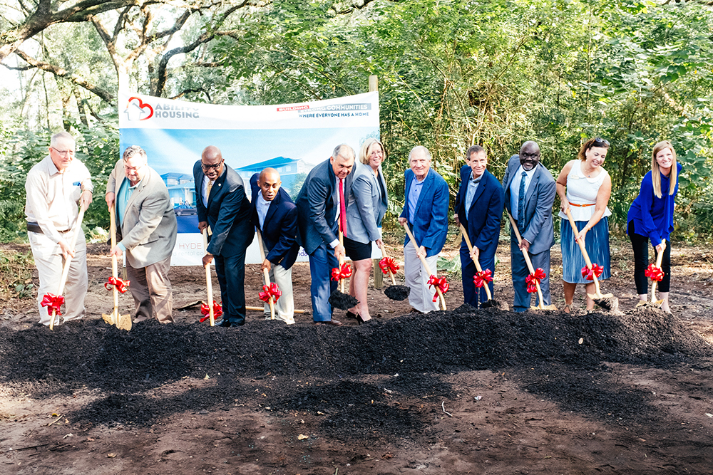 Jim Pellot, Ross McWilliams, Dr. Charles Moreland, Garrett Dennis, Mel Martinez, Shannon Nazworth, Davis McCarty, Greg Matovina, Sam Newby, Michelle Barth and Ann Reinert lift shovels at the Ability Housing groundbreaking Oct. 25 in Hyde Park.