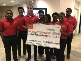 Teen servant leaders, ages 13-18, in I'm A Star Foundation presented a check for $30,000 before the Duval County Public School Board Nov. 7.