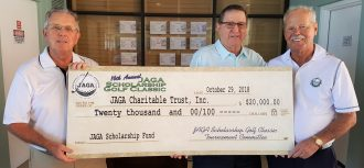JAGA Scholarship Trust officers Bob Streightiff (left) and Ken Hicks (right), with tournament chair Adair Roberts.