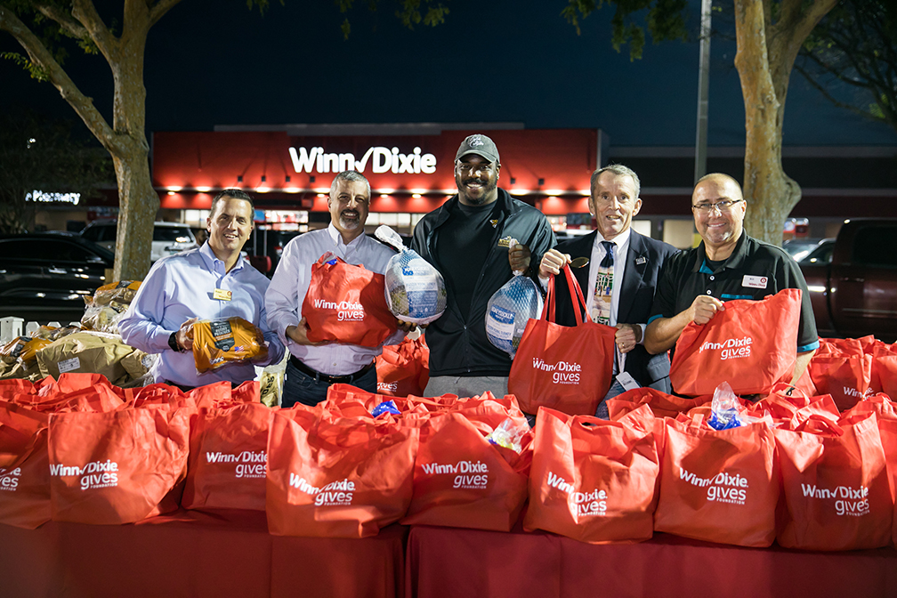 Jaguars' Malik Jackson, the USO and Winn-Dixie give 300 turkeys to military families to celebrate the Thanksgiving holiday. (Deremer Studios Jacksonville Commercial Photography)