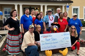 Team members from David Weekley Homes donated more than 1,200 turkeys and nearly 4,500 pounds of nonperishable food items to Farm Share, Inc. to benefit families in need.