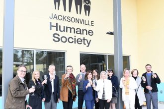 Board members Mike Gehlen, Kristine Cherek, Gary Meeks, Lisé Everly, Sean Lueck and Linda Berry Stein with Development Director Theresa Scordo, Chief Executive Officer Denise Deisler, Nancy Peterman, Chief Operating Officer Nikki Harris, Ann Korczyk and Chief Medical Officer Dr. Stan Hill raised a toast at a special campaign recognition ceremony to honor Linda Stein.
