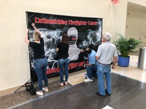 Middleburg High School students helped raise awareness of firefighter cancer and recruited firefighters from throughout the state to sign the banner that honors fallen firefighters.