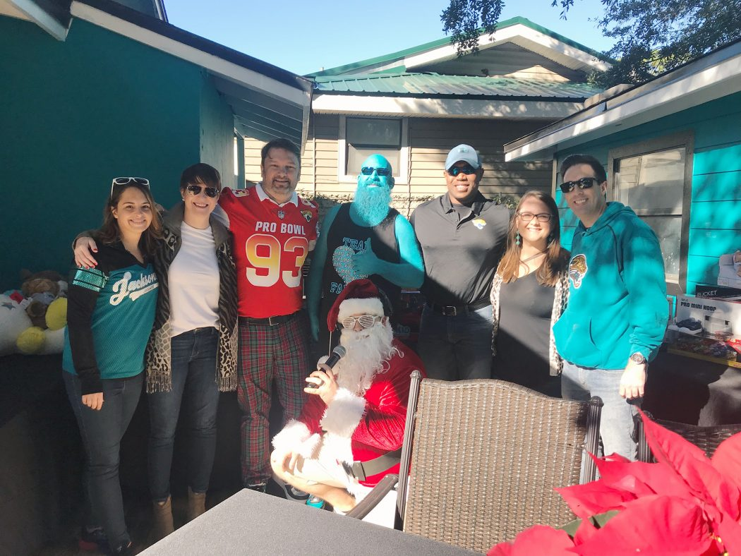 Sarah Stec and Courtney Weatherby-Hunter with Children's Home Society, Attorney John Phillips, Teal Man, and Kevin Copeland, CHS board member with Jessica Henderson and Dave Cognetta, of CHS...and Santa!
