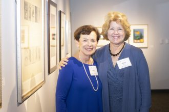 UNF Alumna Judy Eisen and Debra Murphy, chair and professor of UNF's Department of Art and Design, in the UNF Gallery of Art where Eisen's donation of artwork will be exhibited through Thursday, Feb. 14
