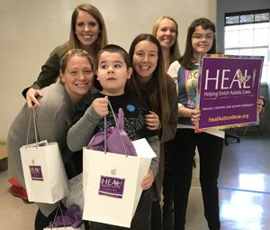 HEAL Founder Leslie Weed and Executive Director Jason Gurka deliver iPads to Growing Together Behavioral Center. To date, HEAL has gifted 400 iPads to local ESE classrooms.