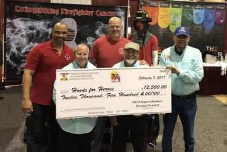 The Florida RV Trade Association presents Hoods for Heroes with a special check during its annual RV Mega Show on Feb. 9, at the Jacksonville Equestrian Center. FRVTA donated a portion of its revenues from the event, along with a donation from the members of the FRVTA Region 6/NE Florida RV Dealers, Campgrounds, & Suppliers.