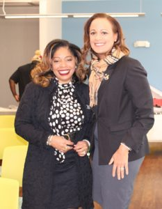 Jannet Walker Ford and Tracey Holzendorf, members of Bold City (FL) Chapter of the Links, Incorporated, attend the ribbon-cutting event on Jan. 25 for the grand opening of the stocked library for Sulzbacher Village.