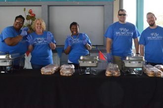 FSSNF staff and volunteers prepare to serve lunch to caregivers.