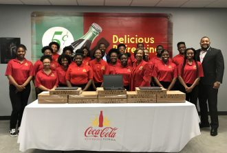 I'm A Star students receive laptops donated by Coke Florida in honor of Black History Month during a ceremony and tour of Coca-Cola Beverages Florida on Feb. 14.