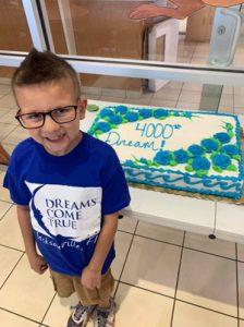 Logan prepares to share his cake as Dreams Come True's 4,000th dream.