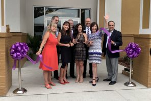 (Front): Amy Davis, Andrea Fritz, Christine Chapman, Susan Ponder-Stansel, (back) Jim Monaham, John Mcllvaine, Phil Ward and Carlos Bosque celebrate the opening of Community Hospice's Stephen R. Chapman Family Community Campus in St. Augustine.
