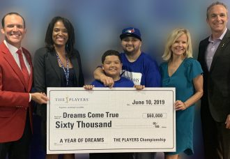 Dreams Come True was given a birthday surprise on Monday, June 10 when THE PLAYERS presented the locally based dream-granting organization with a $60,000 donation and a special birthday greeting from PGA TOUR member Fred Couples. (L-R) Adam Campbell, 2019 Tournament chairman, THE PLAYERS; Marsha Oliver, senior director, Community Outreach, THE PLAYERS; Dreamer Cristian Bernal (age 11) and his father John Bernal. Cristian's Disney Dream in April 2019 was sponsored by THE PLAYERS; Sheri Criswell, executive director, Dreams Come True; Jared Rice, executive director, THE PLAYERS.