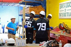Members of the Jaguars rookie class took the firstOne Team. One Home.shift of the year on June 17, building the frame for a new house at the HabiJax warehouse.