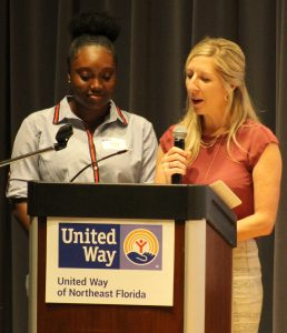 Achiever For Life mentee, Jazzlyn and her mentor Sara McMillan, Vice President, Development at The Arc of Jacksonville speak to United Way of Northeast Florida volunteers at the annual Volunteer United celebration held on June 5 at the Main Library Downtown.