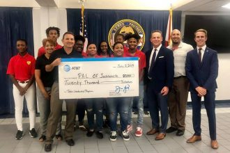 AT&T representatives present a check for $20,000 from the AT&T Foundation to Sheriff Mike Williams and JaxPAL Teen Leaders.