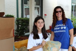 Volunteers Cheyenne Morales and Tiffany Turner helped distribute food to Clay county families at United Way of Northeast Florida's Day of Action on June 21.