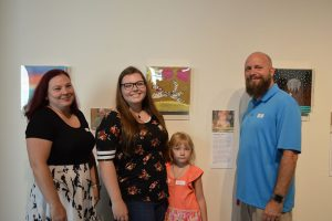 Madison and her family at Art With a Heart in Healthcare's annual exhibit at MOCA.