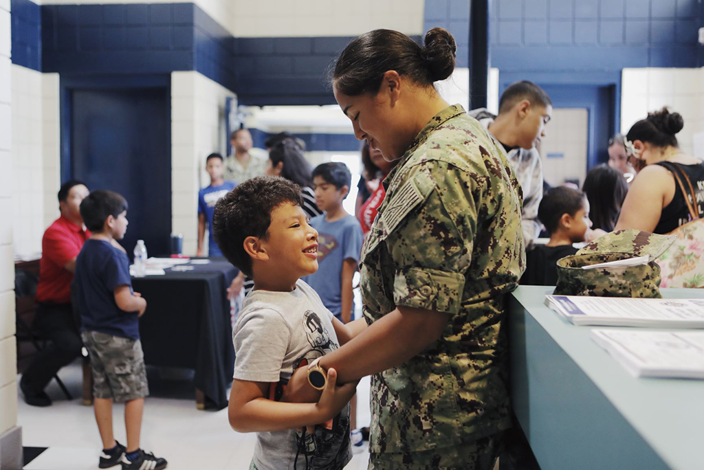 A military mother and son at the Operation Homefront Back-To-School Brigade(R) August 9.