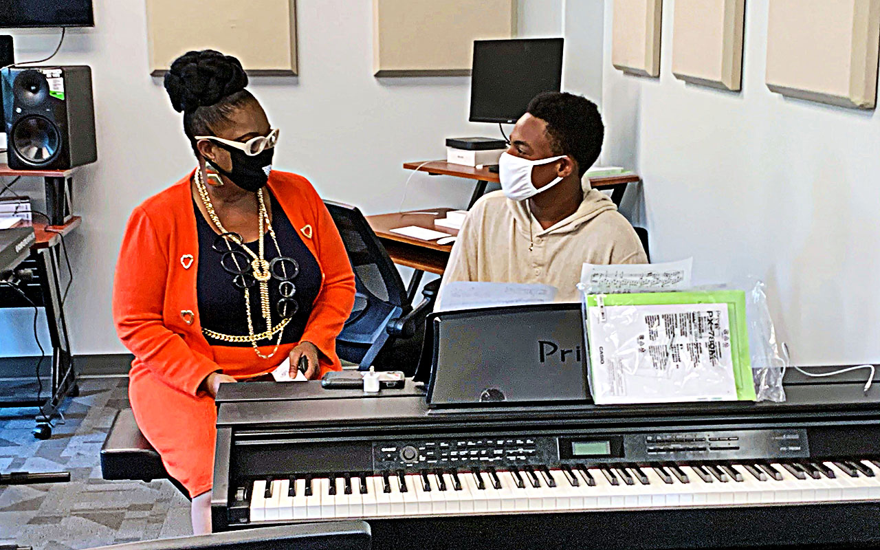 Council Member Ju'Coby Pittman with MWYF student, Kendall F., in Club 904's music room